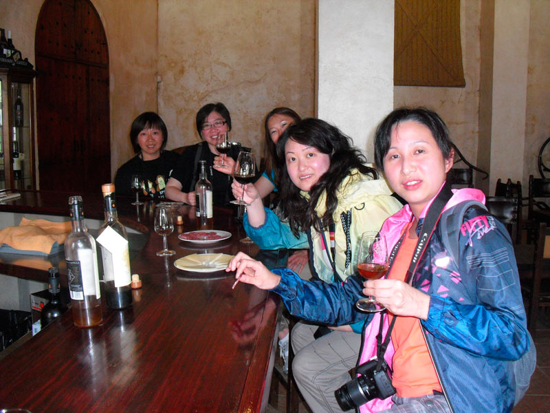 A group of Chinese women sitting down and tasting sherry on our sherry tour