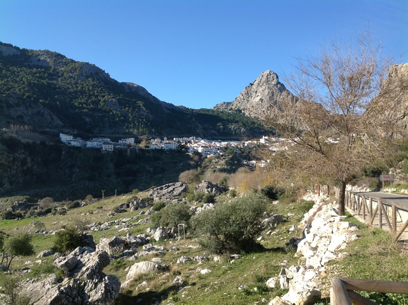 A view form the distance of the town of Grazalema with mountains behind