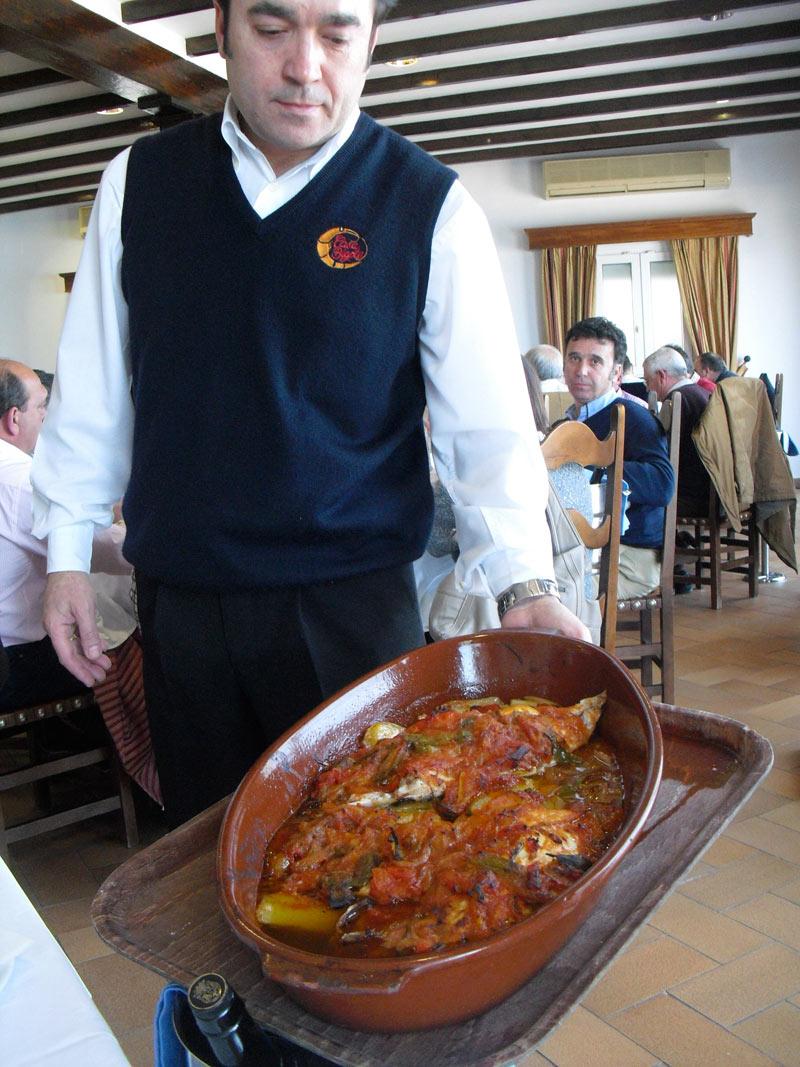 Baked fish with vegetables in a restuarant in Sanlucar de Barrameda
