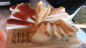 Four different sliced cheeses for tasting