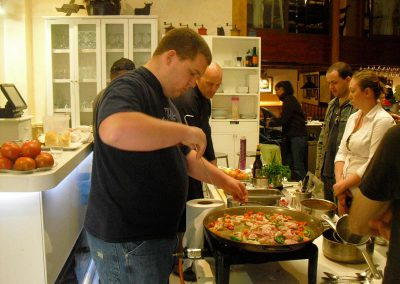 Cooking paella in our cooking classes in Seville