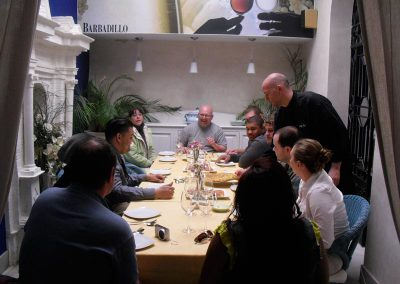 Group sitting down to eat after cooking classes