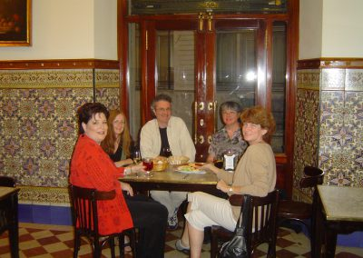 On our tapas tour, eating tapas at a bar in Seville