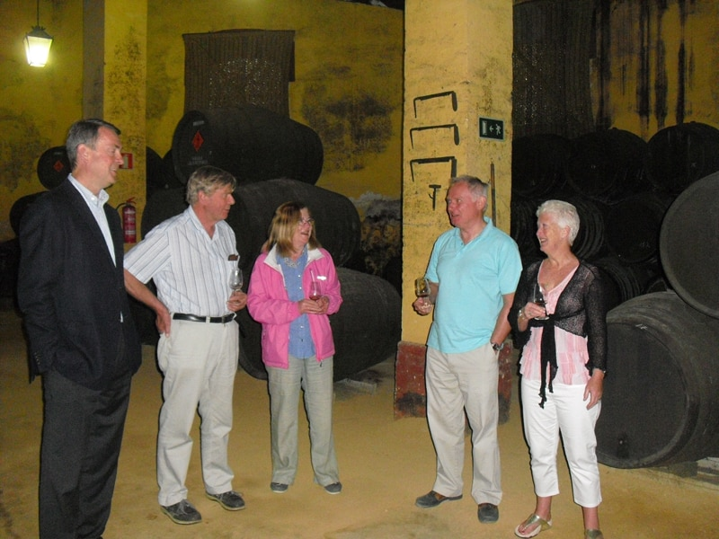 A group of clients from the UK visiting a sherry winery
