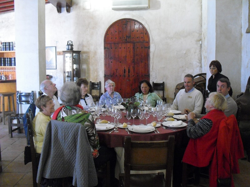 A group of people having a meal at a winery in Jerez de la Frontera during our sherry tour