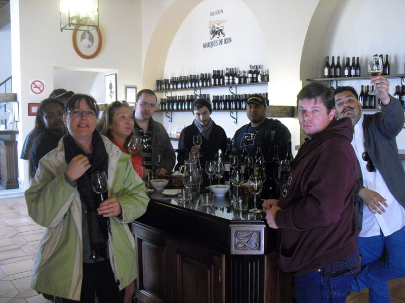A group of people tasting sherry in the tasting room of a sherry winery