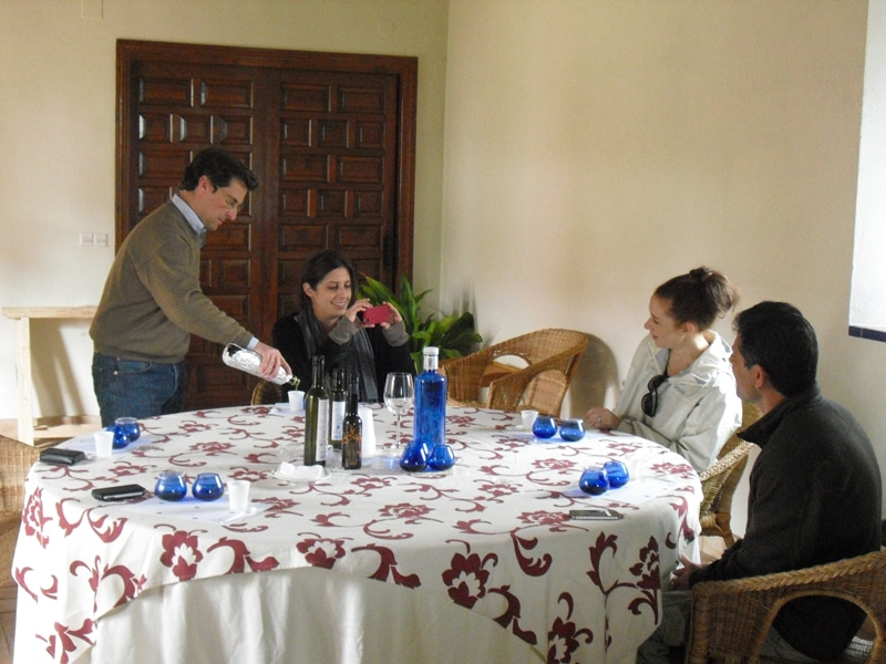A group around a table tasting olive oil