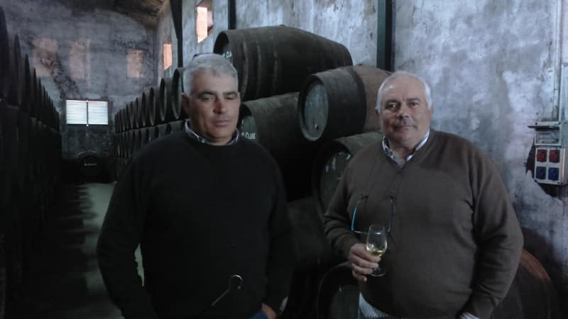 Two people in a winery building