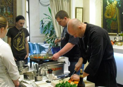 Making paella in our cooking classes in Seville