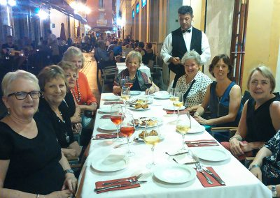 On our tapas tour, a group of women siting around a table outside a tapas bar in Seville