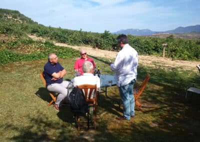On our customised tours, tasting wine outside at a vineyard in La Rioja