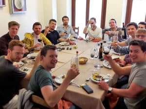 A large group around a table at a wine tasting