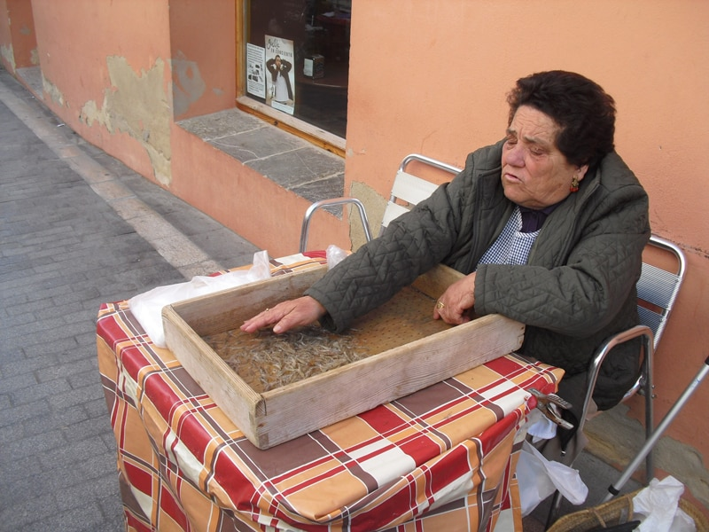 Woman seeling shrimo in the street Sanlucar de Barrameda